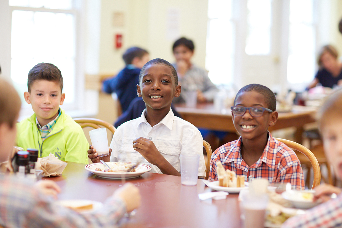 Three Landon lower school boys enjoy their lunch in the school restaurant