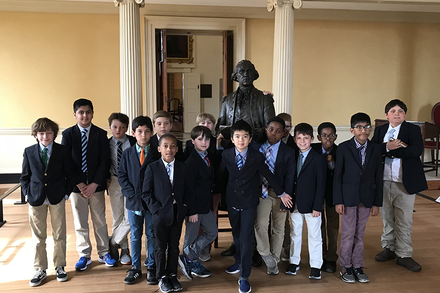 Landon boys standing in front of a statue during one of their educational trips