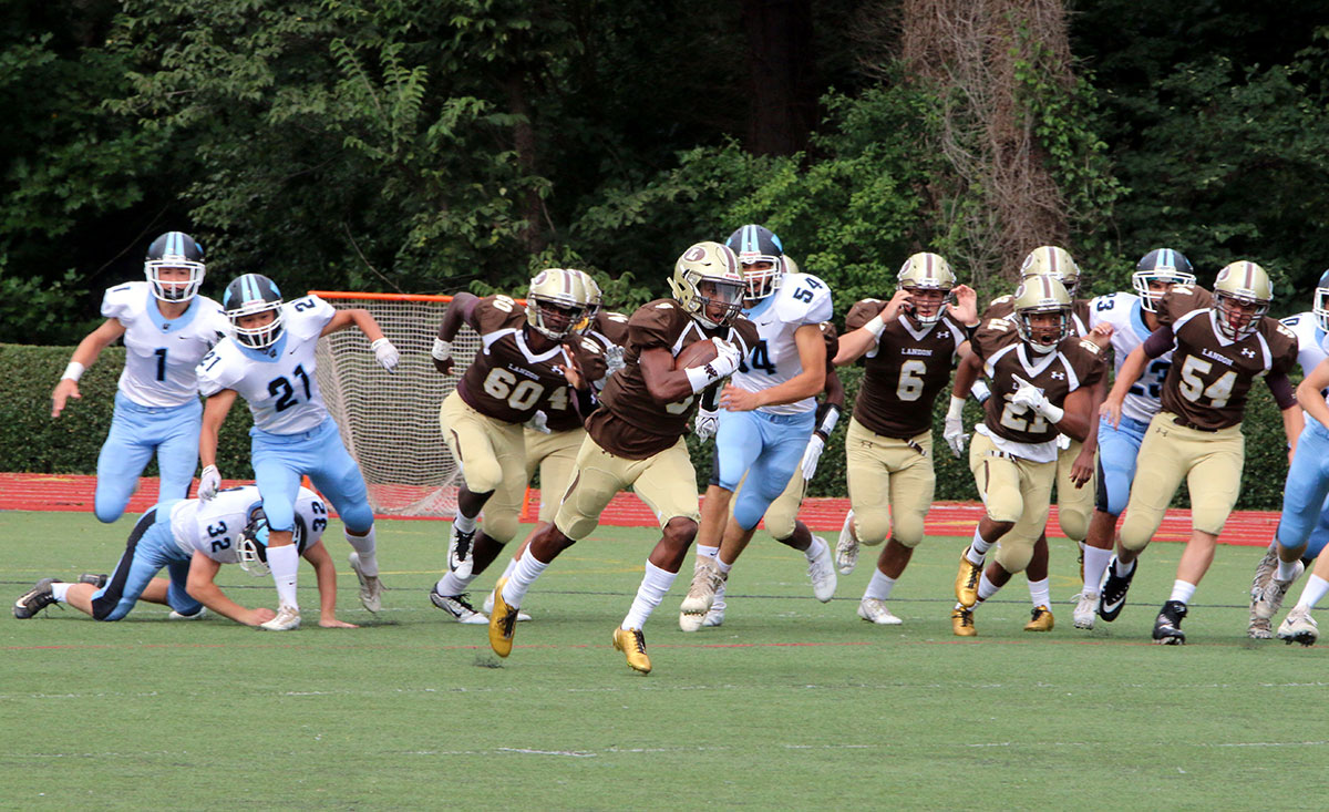 Landon Upper School football team in action and heading for the touch line.
